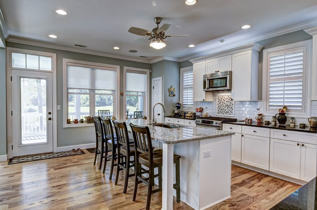 Beautiful kitchen remodel with granite countertops, stainless appliances and hardwood floors.